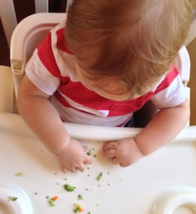 Toddler self eating finger food