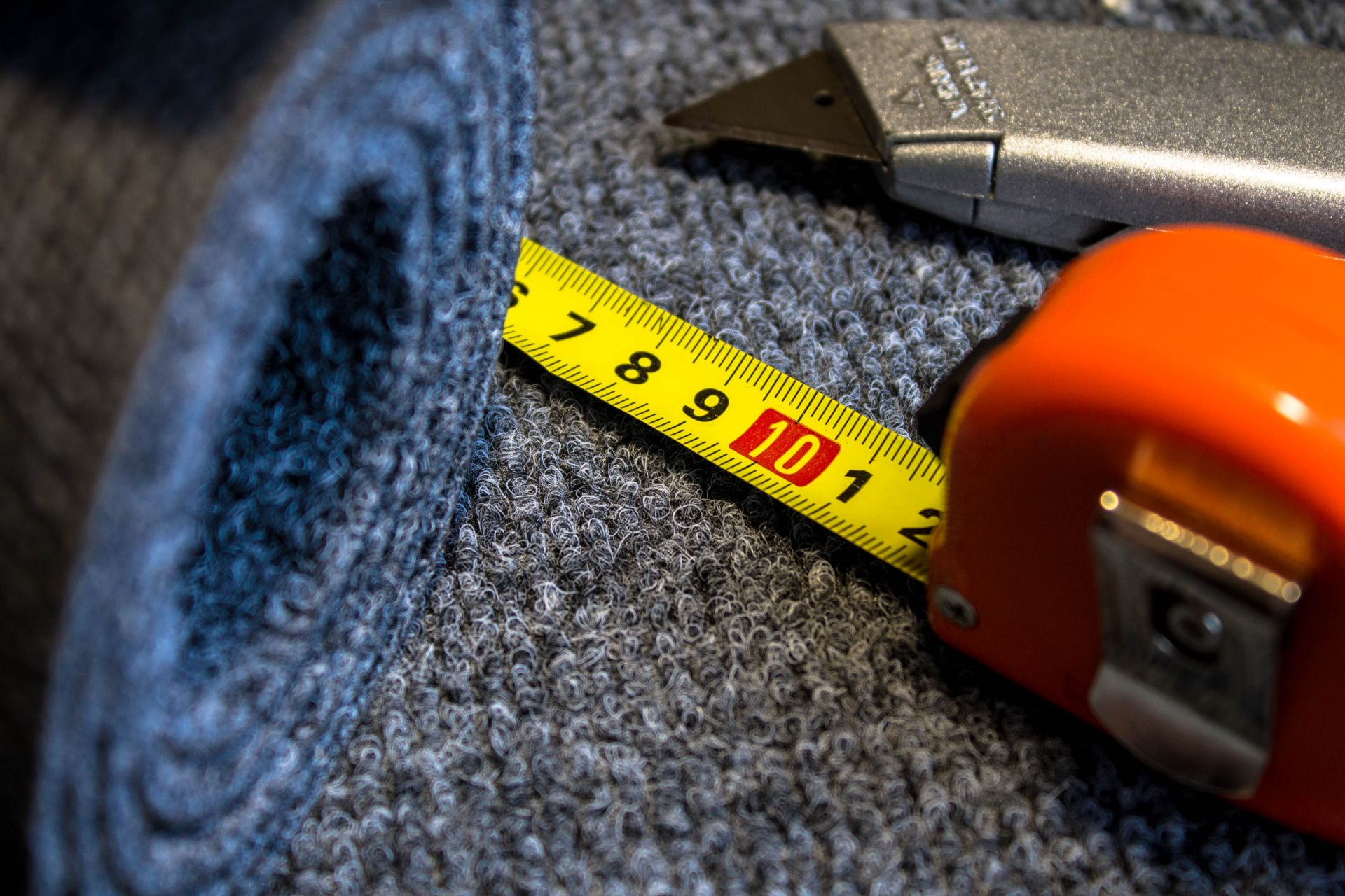 Carpet with measuring tape and cutter