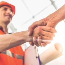 workers-shaking-hands