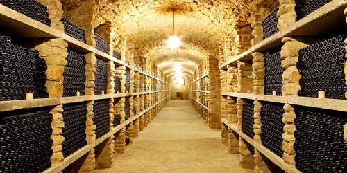Old cellar of the winery with bottles of wine