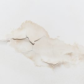 Big wet spots and cracks on the ceiling of the domestic house