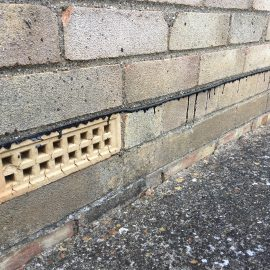 Line of bitumen damp proof membrane and a ventilation air brick