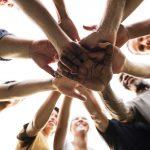 Diverse Group of People Hands Together Partnership Teamwork