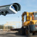 CCTV camera in the foreground of heavy construction machine
