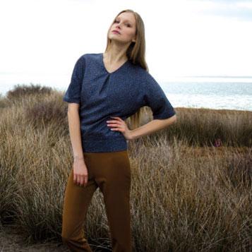 Model in field in wool outfit