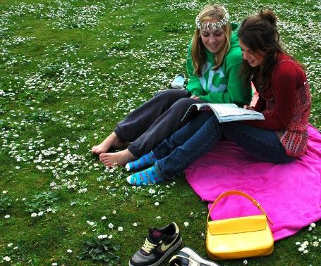 Women reading in park