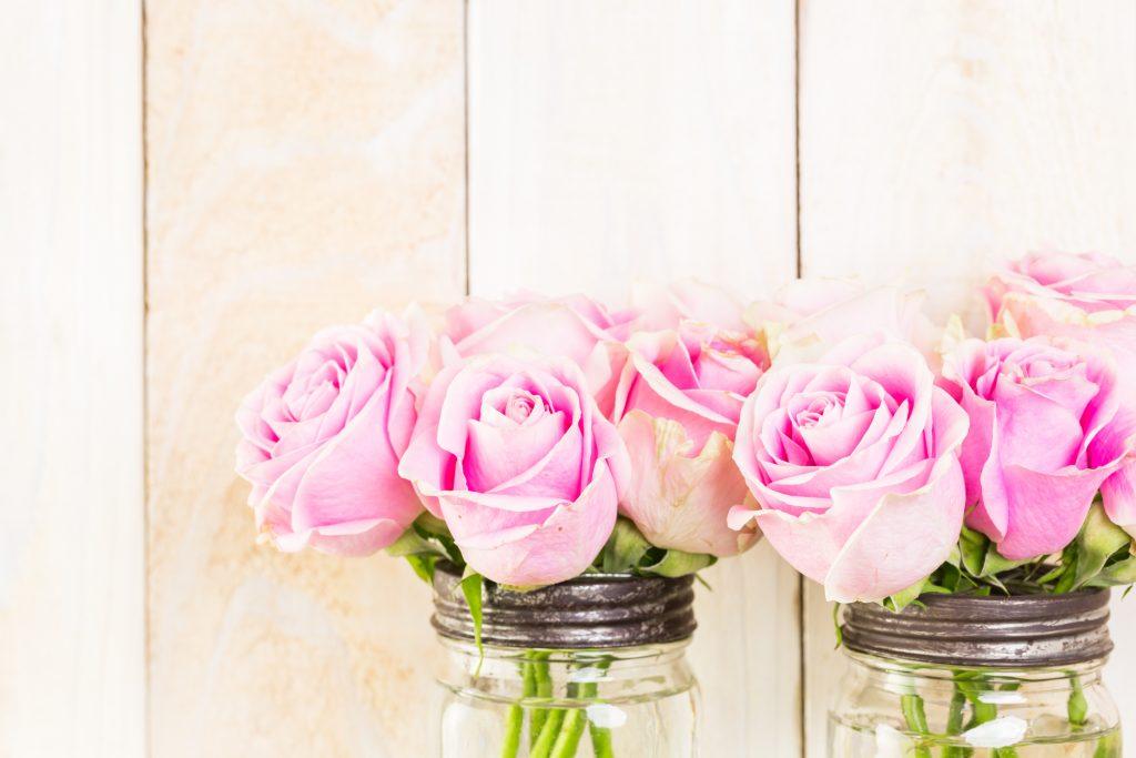 Repurposed flower vases.