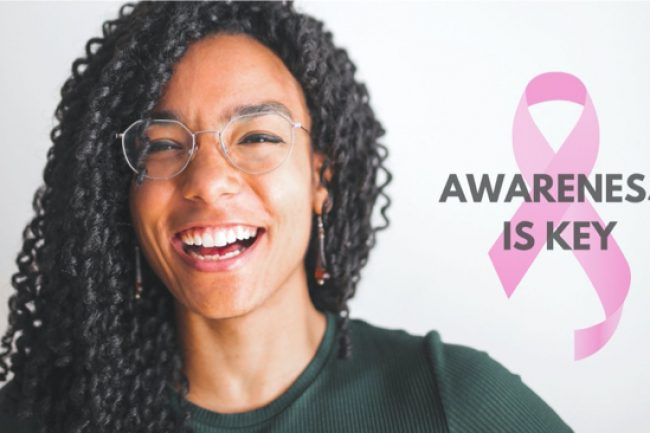 happy girl featuring next to breast cancer ribbon with awareness is key slogan