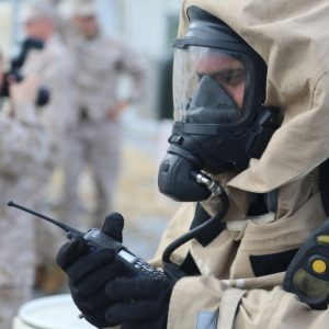 U.S. Marine Lance Cpl. Jesus Medina, a reconnaissance team leader with Combat Logistics Regiment 37, uses a radio to communicate with other Marines during a Chemical, Biological, Radiological and Nuclear (CBRN) training exercise at Camp Kinser, Okinawa, Japan, Aug. 22, 2012. The CBRN evaluation tested the Marines' ability to perform in a simulated stress environment. (DoD photo by Cpl. Carl Payne, U.S. Marine Corps/Released)