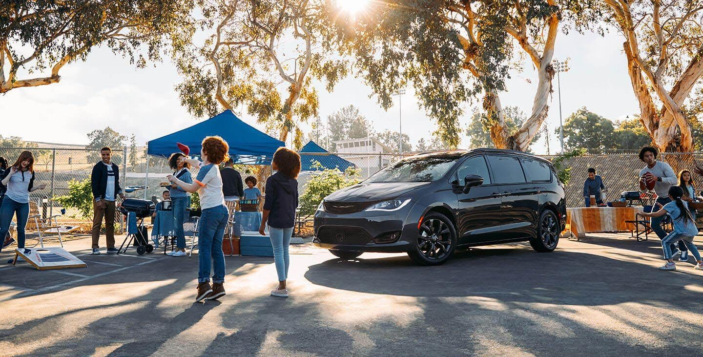 black 2019 chrysler pacifica parked at a cookout
