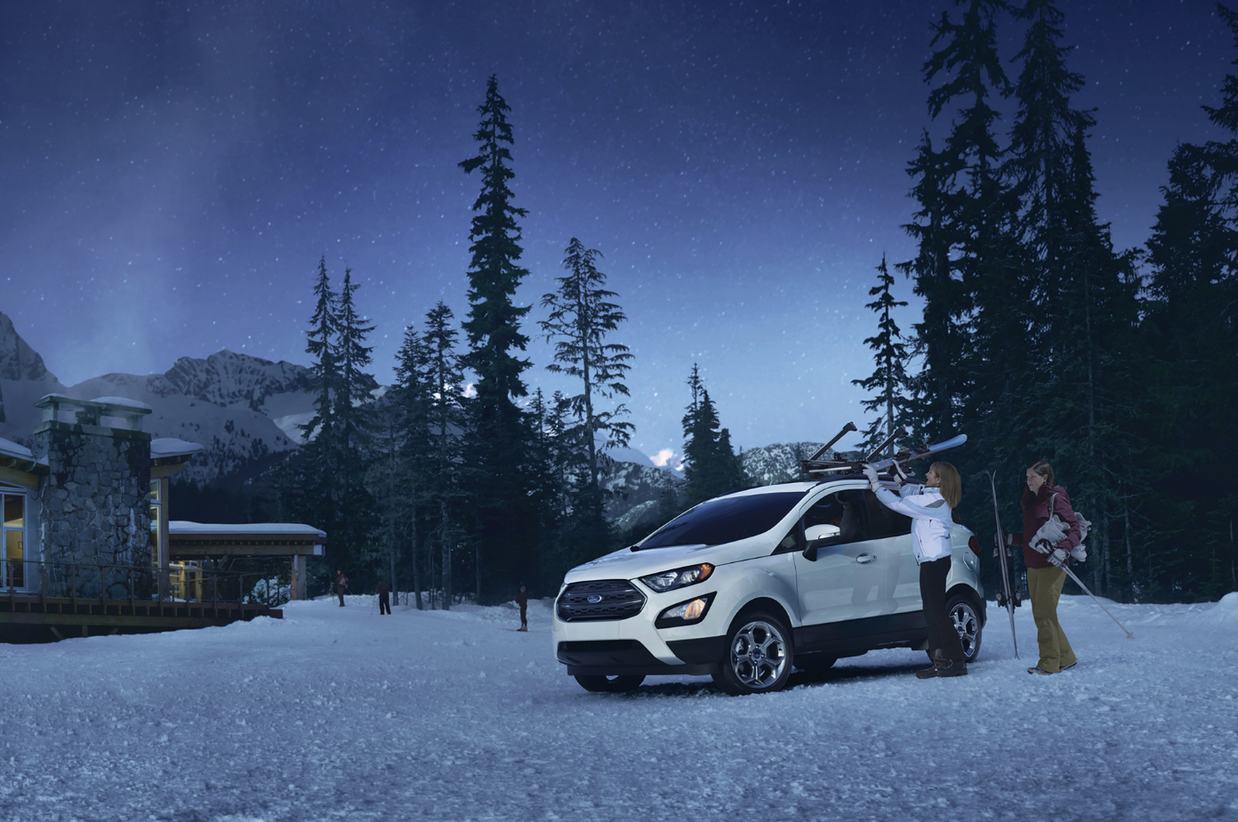 ladies unloading skis off of a white 2019 ford ecosport parked in the snow
