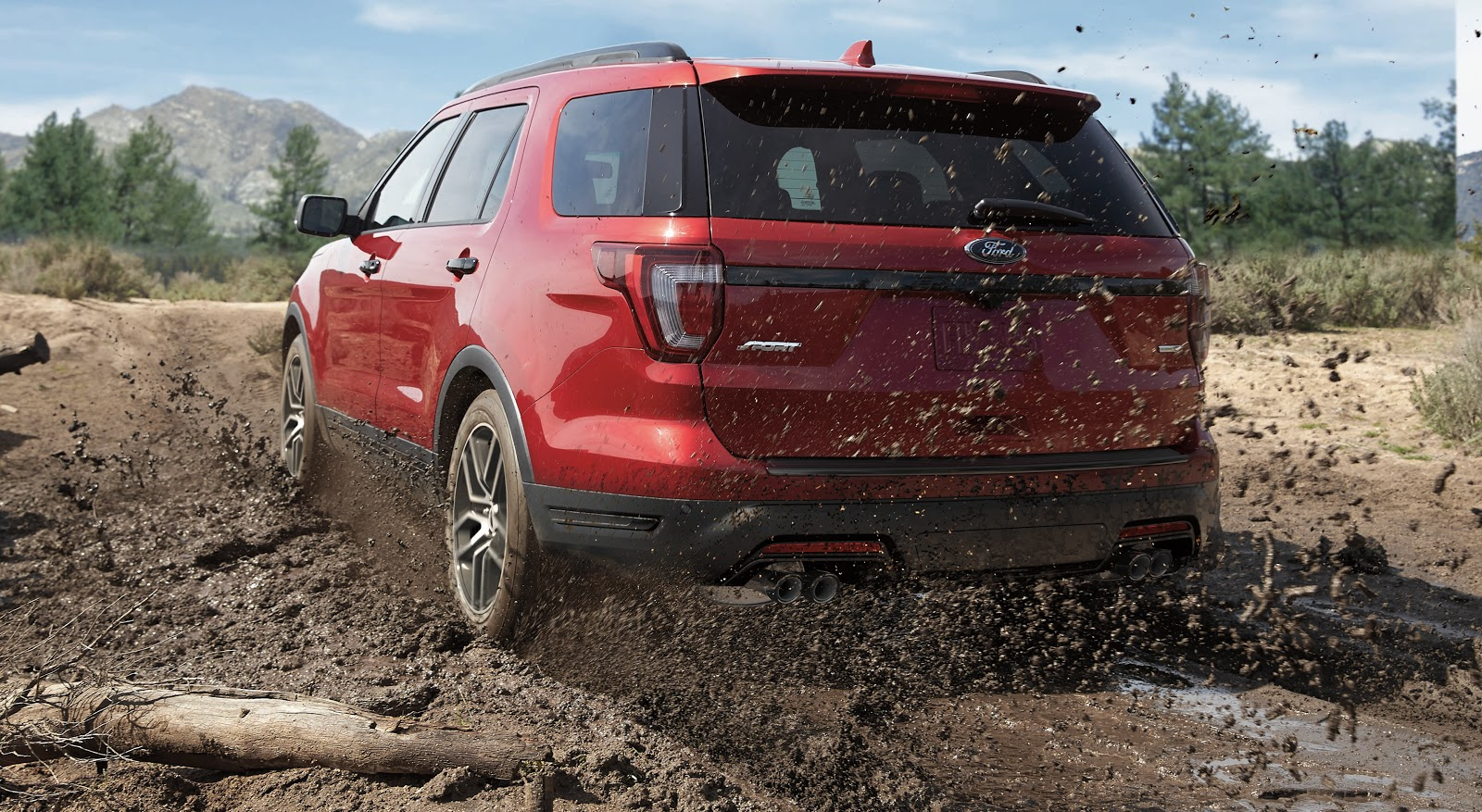 red 2019 ford explorer driving through the mud