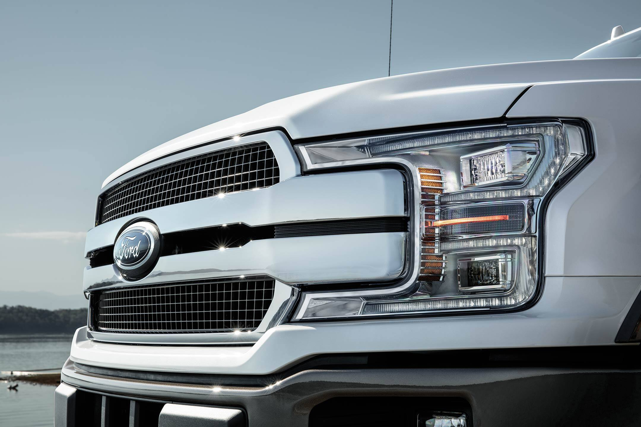 headlight and grille of a white 2019 ford f-150