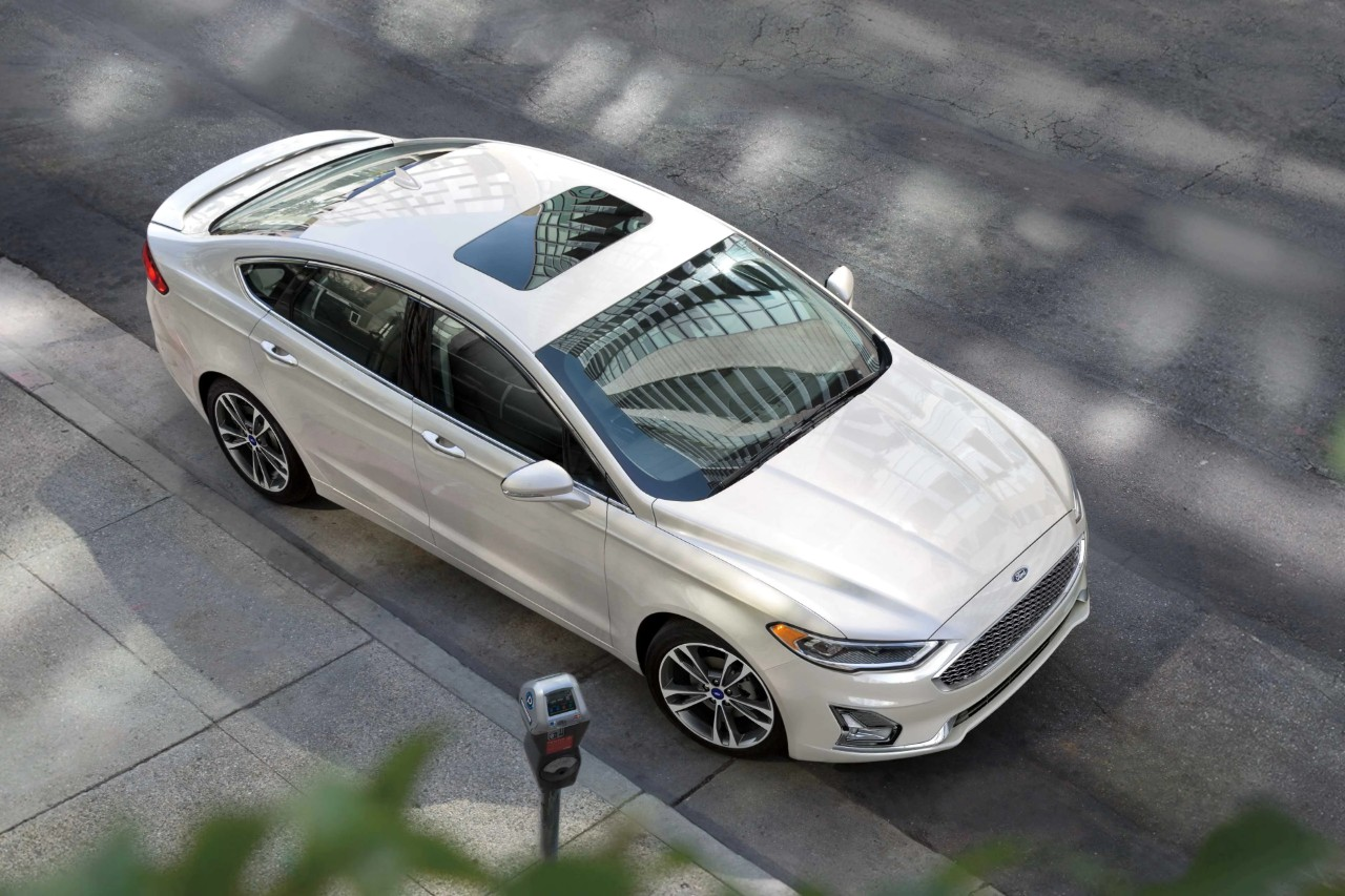 white 2019 ford fusion parked on the street