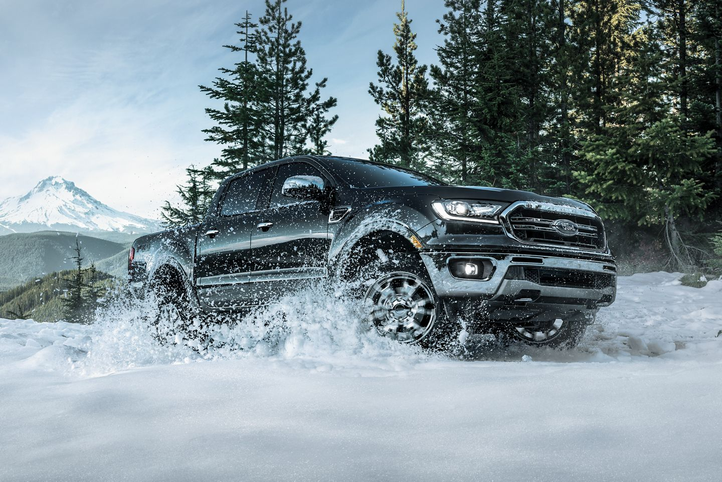 black 209 ford ranger driving in the snow