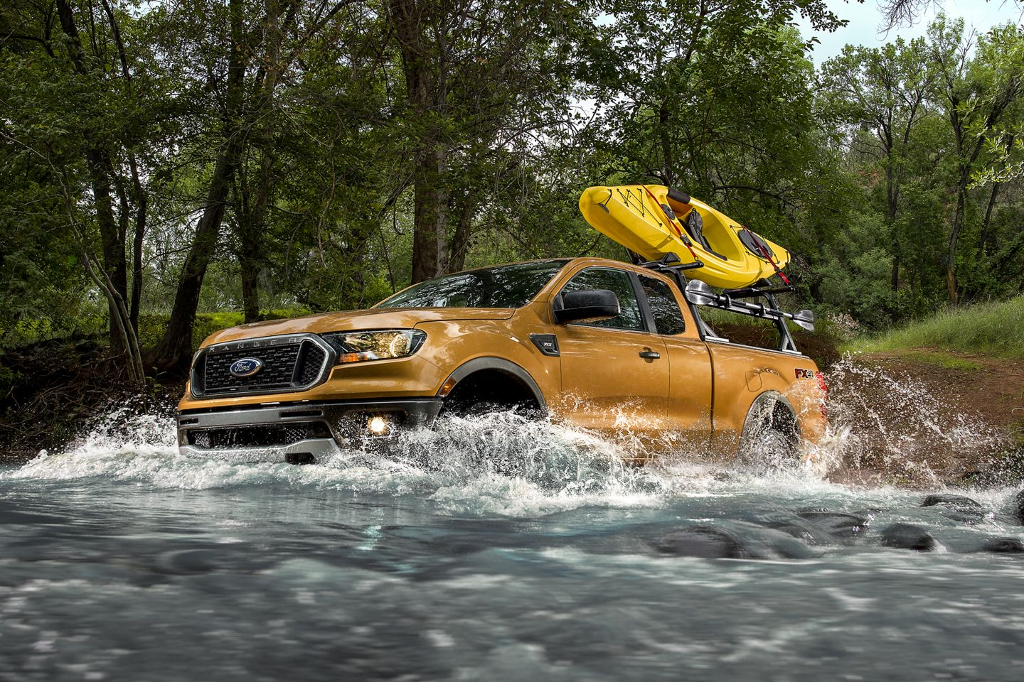 yellow 2019 ford ranger driving through water
