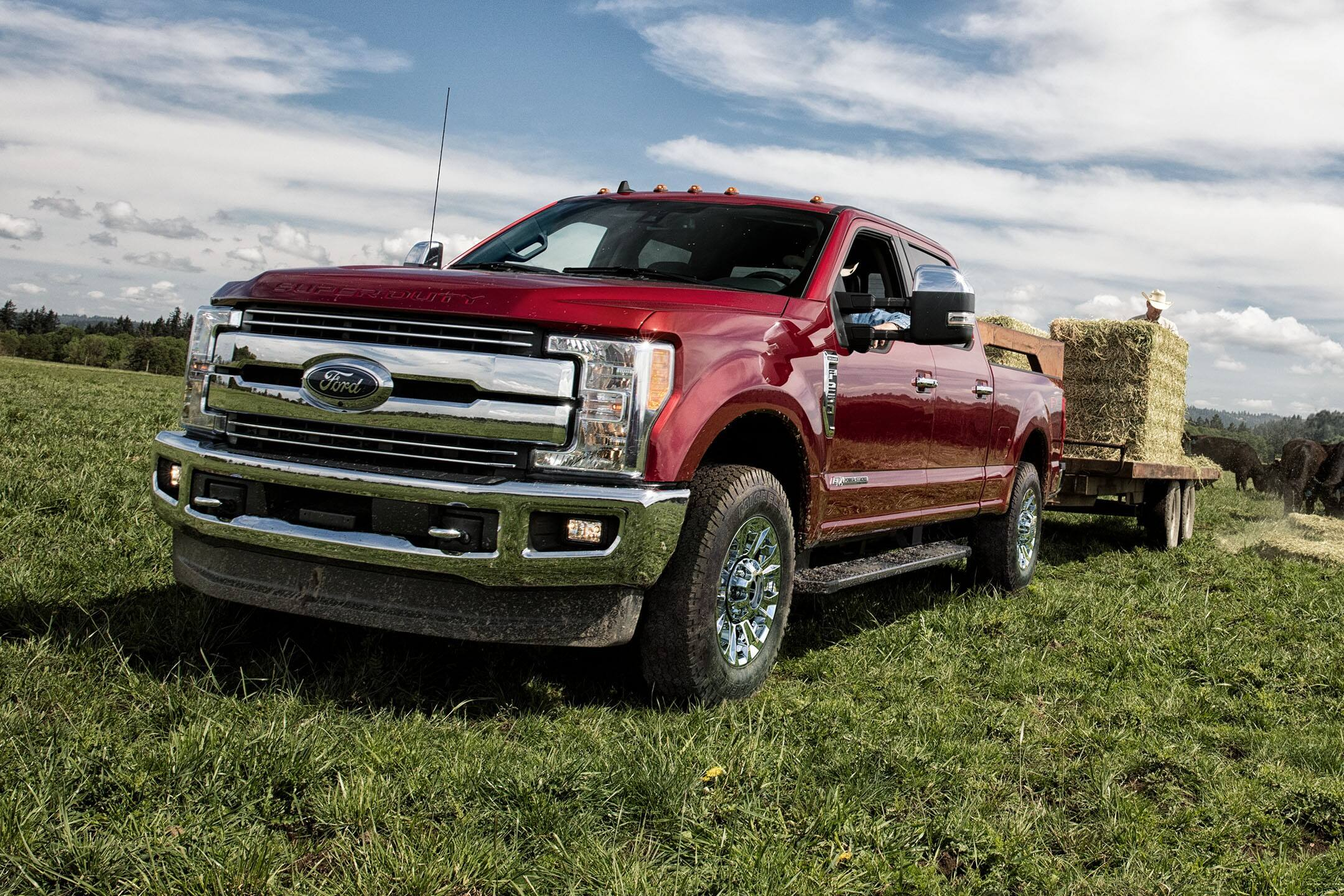 red 2019 ford super duty towing hay
