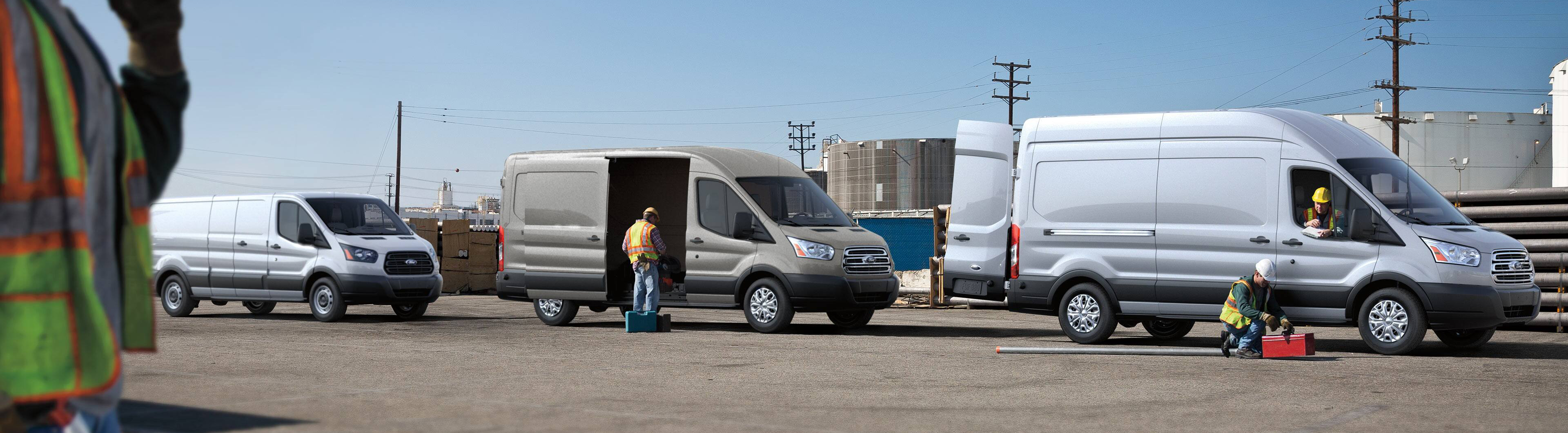 construction works loading and unloading several 2019 ford transit vans