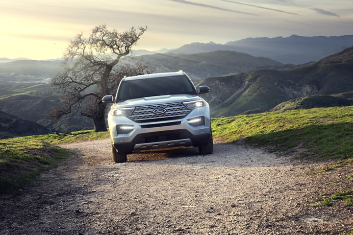 silver 2020 ford explorer driving up a dirt path on a hill