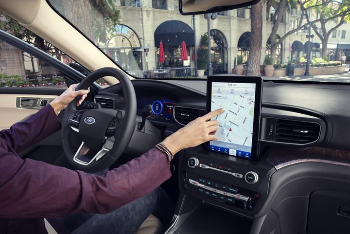 woman using the infotainment system of her 2020 ford explorer