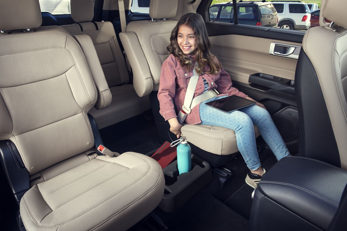 child sitting in the back of a 2020 ford explorer