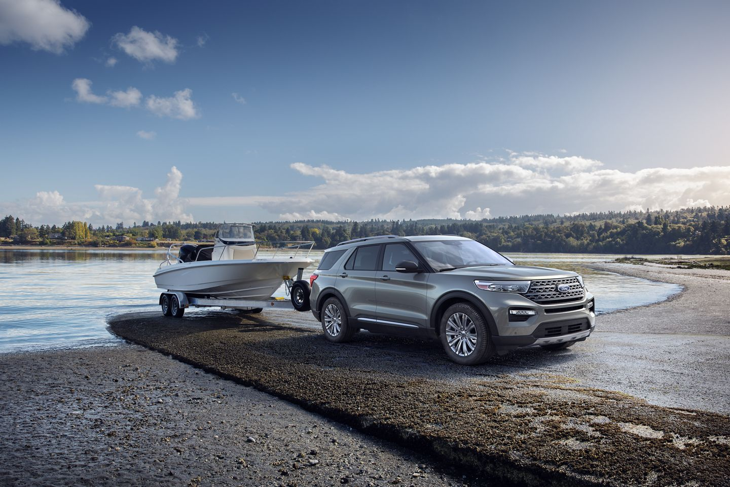 grey 2020 ford explorer towing a boat