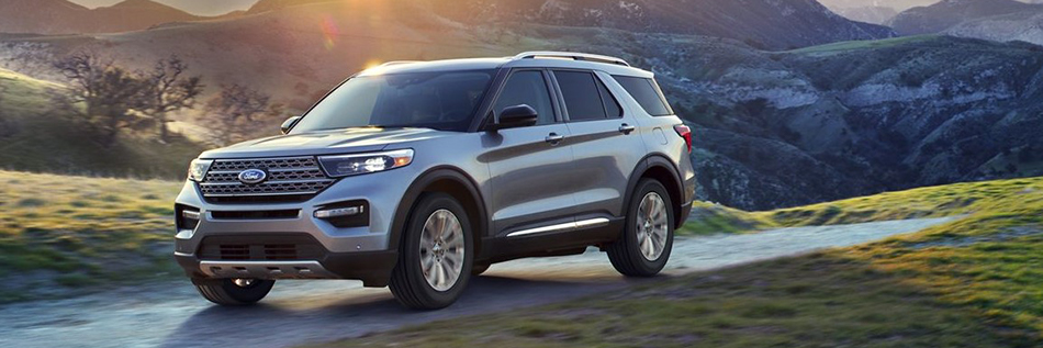 silver 2020 ford explorer driving on a winding road in the hills