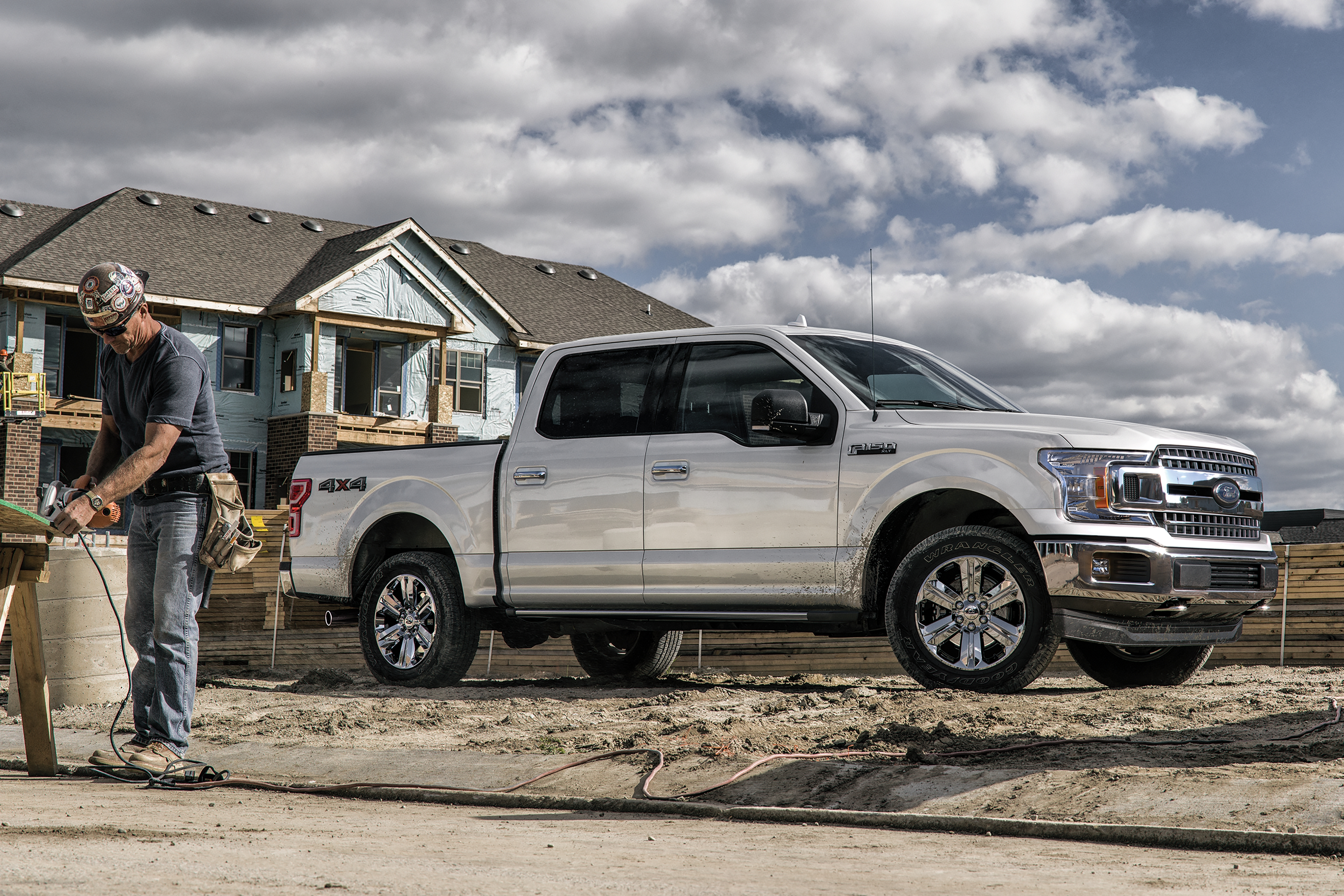 white 2020 ford f-150 parked in front of a house being built