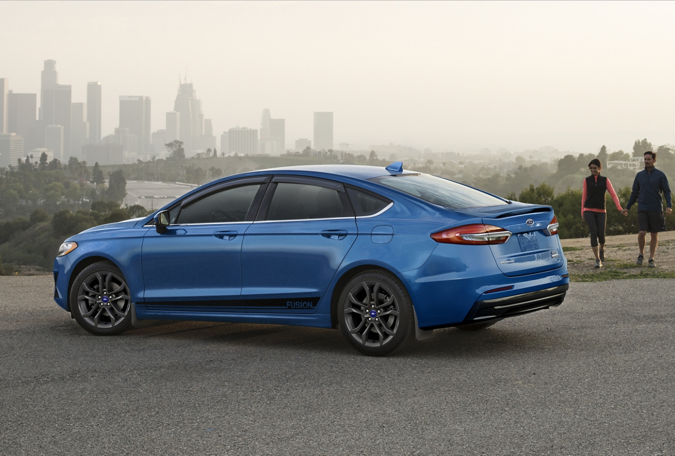 blue 2020 ford fusion parked on a hill top