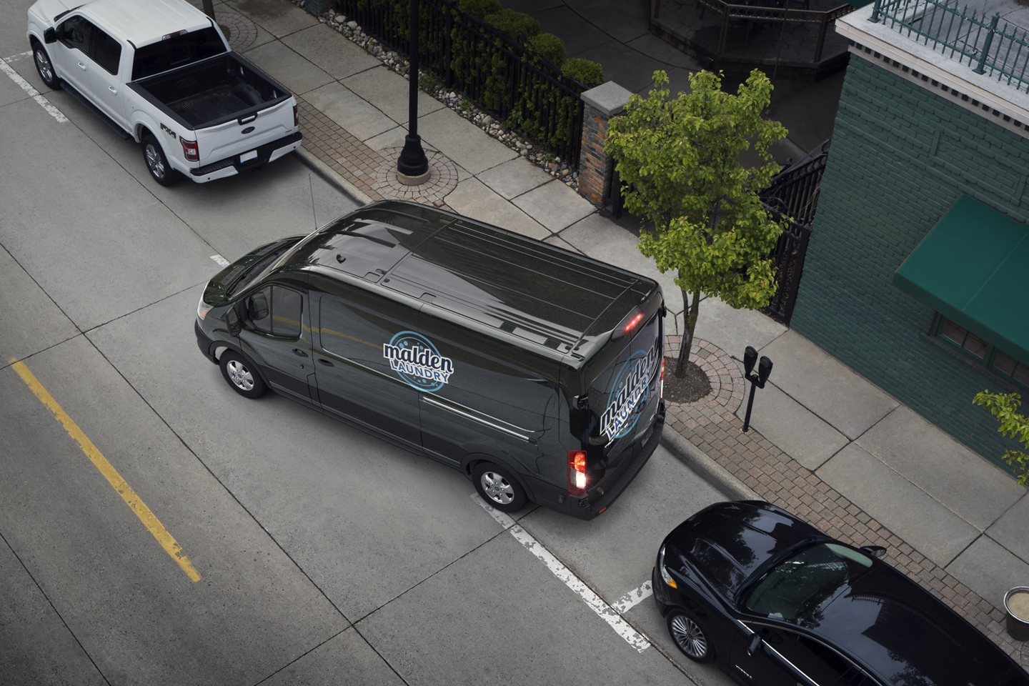 black 2020 ford transit parallel parking with the help of ford's active park assist