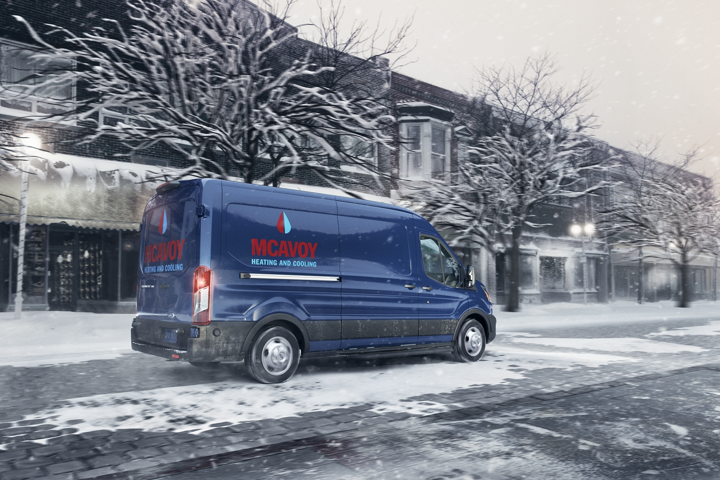 blue 2020 ford transit using it's all wheel drive system on a snowy street