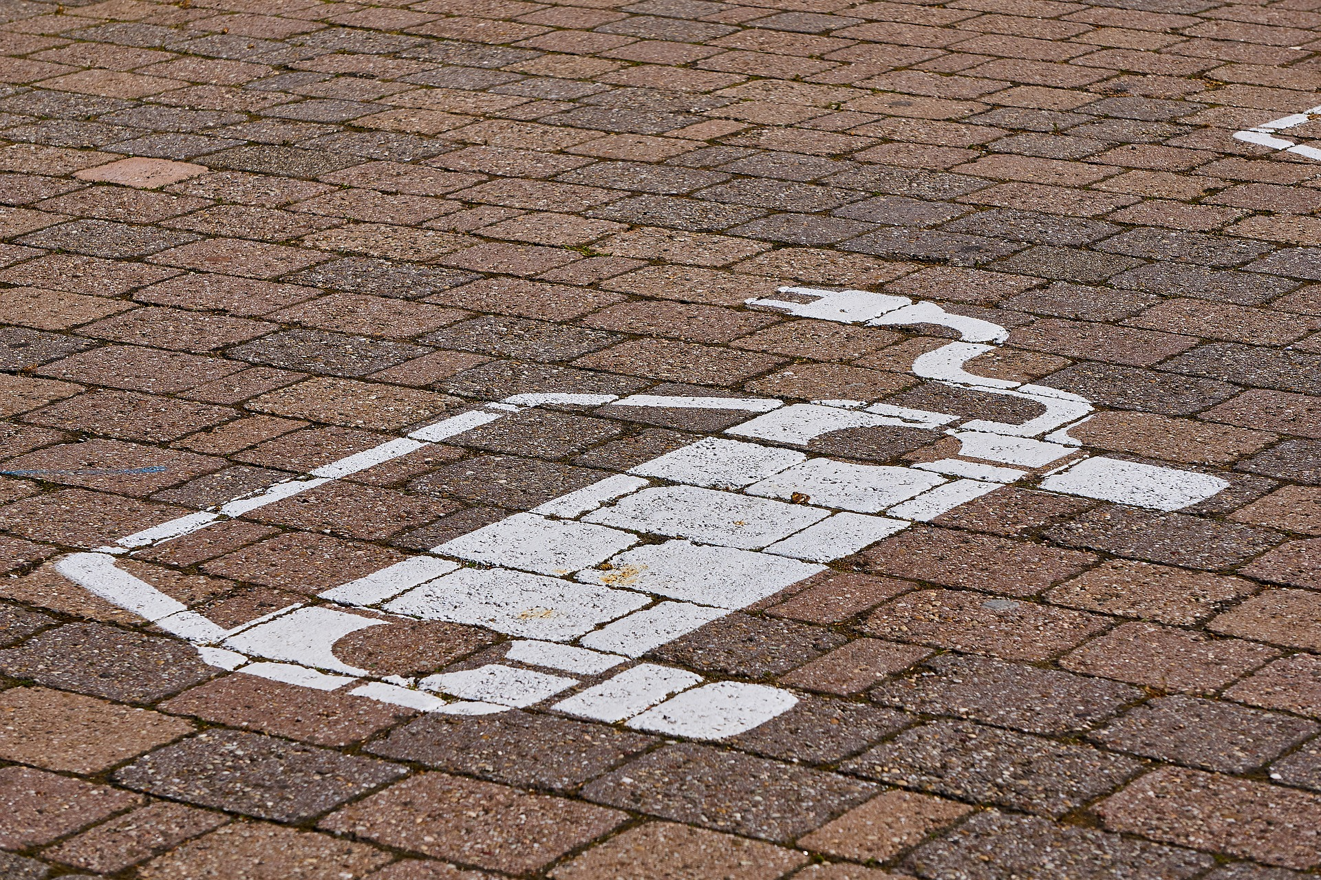electric car icon painted on bricks