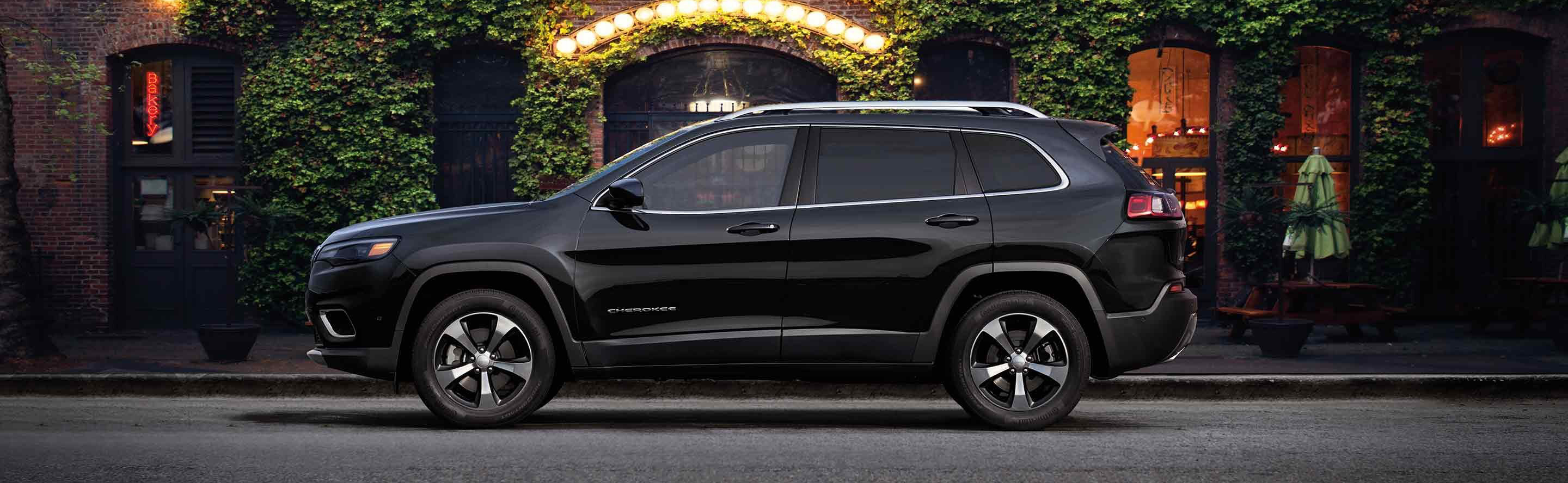 the side of a black 2019 jeep cherokee