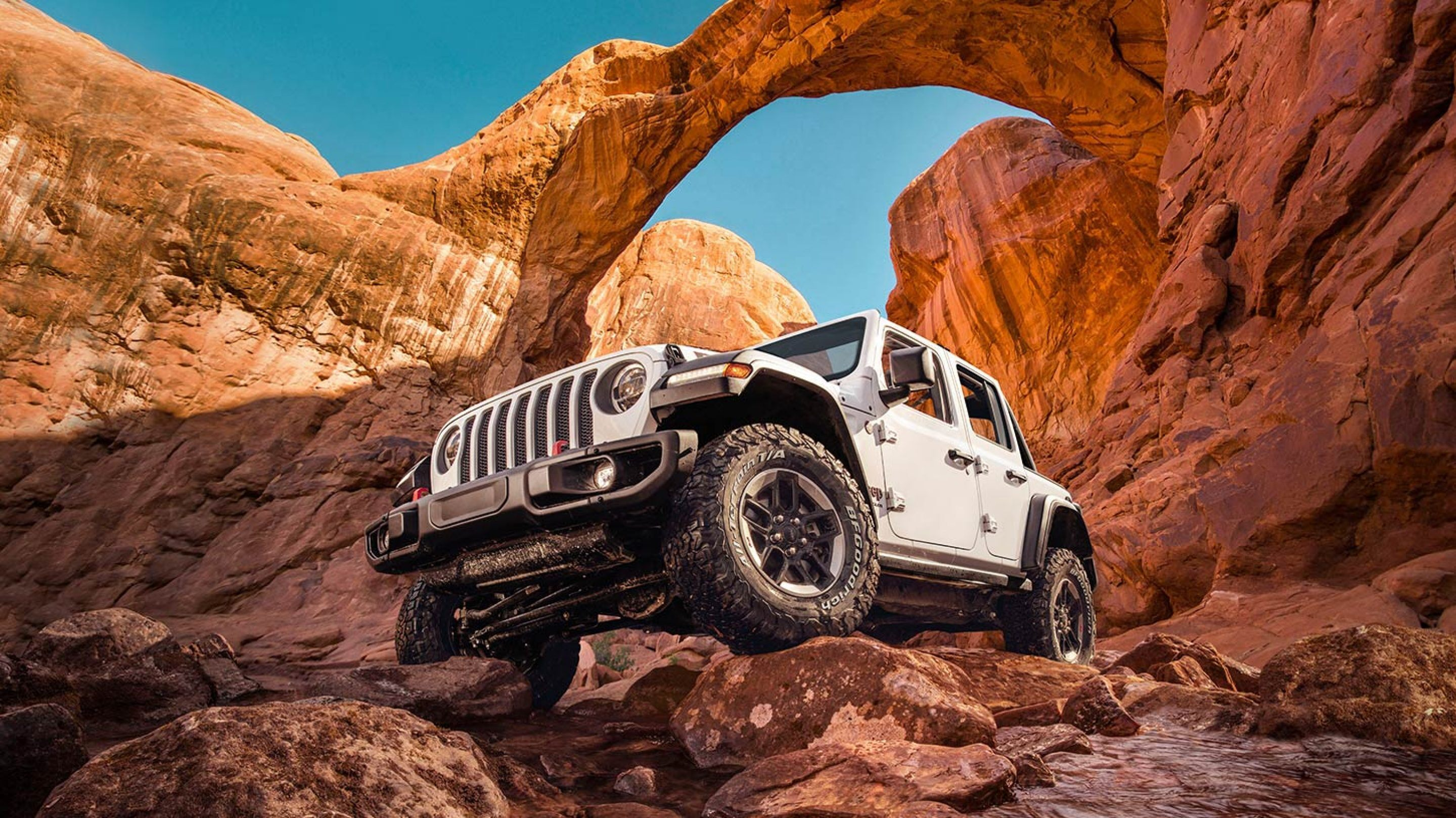 white 2020 jeep wrangler parked in a canyon