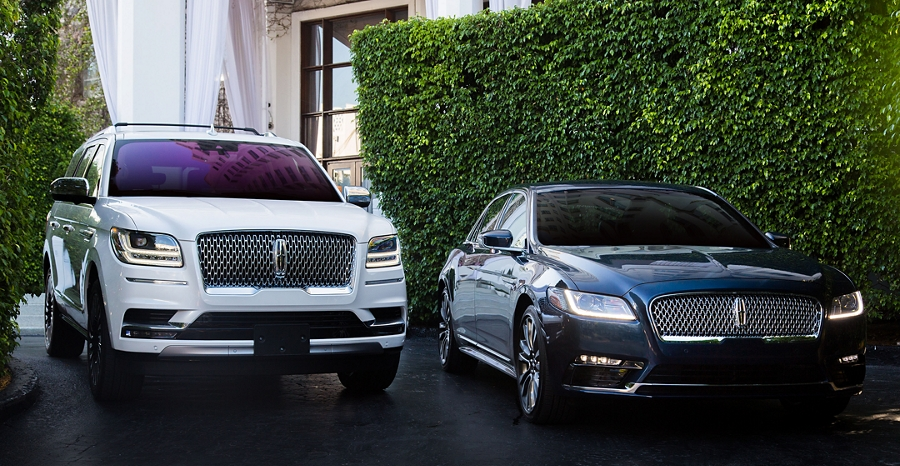 lincoln vehicles parked in driveway