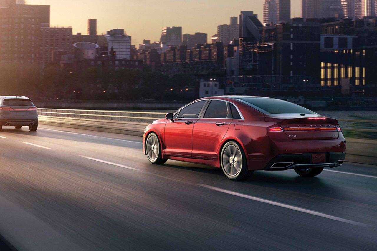 red 2019 lincoln mkz driving down the highway