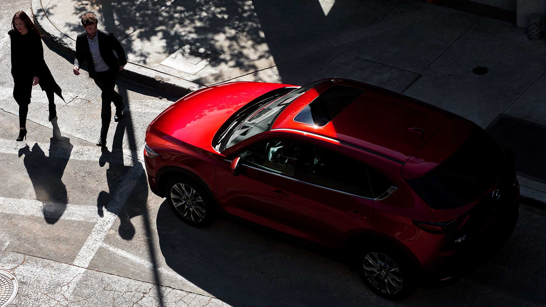 red 2019 mazda cx-5 stopped at a crosswalk