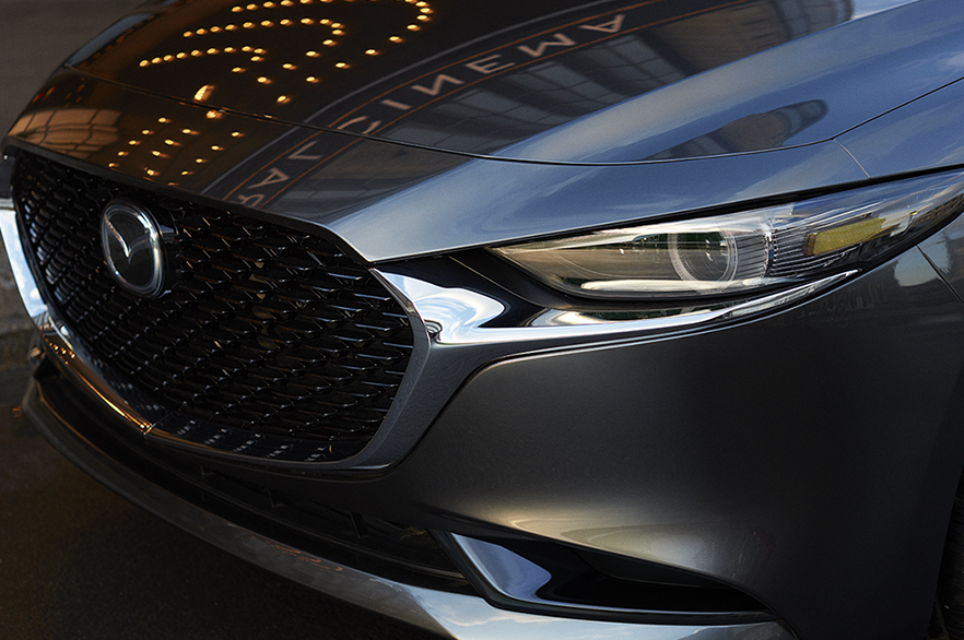 closeup of the front of a grey 2019 mazda3 sedan