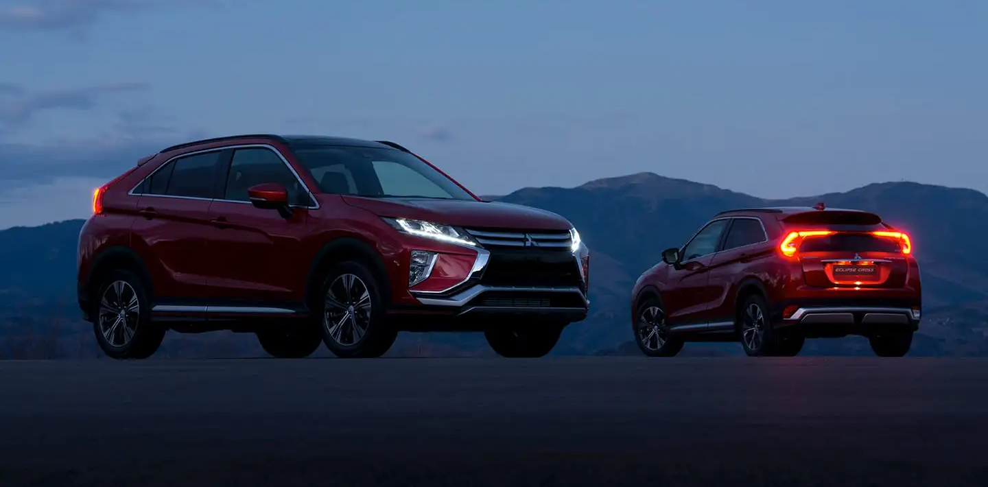 red 2019 mitsubishi eclipse cross parked by mountains front and back