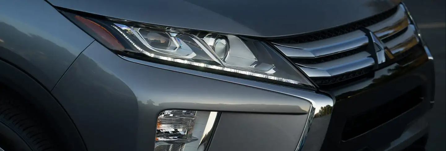 headlight of a silver 2019 mitsubishi eclipse cross