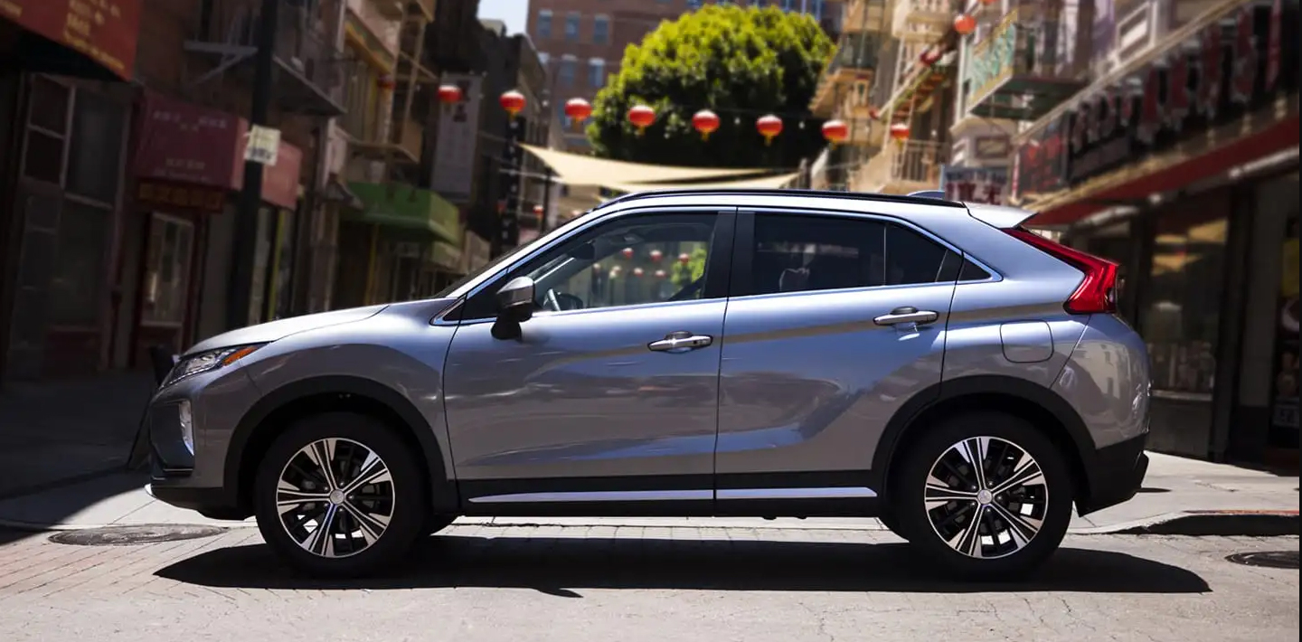 side profile of a silver 2019 mitsubishi eclipse cross parked on the street