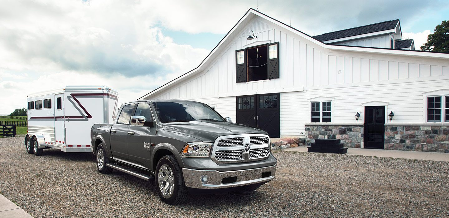 grey 2019 ram 1500 towing a trailer