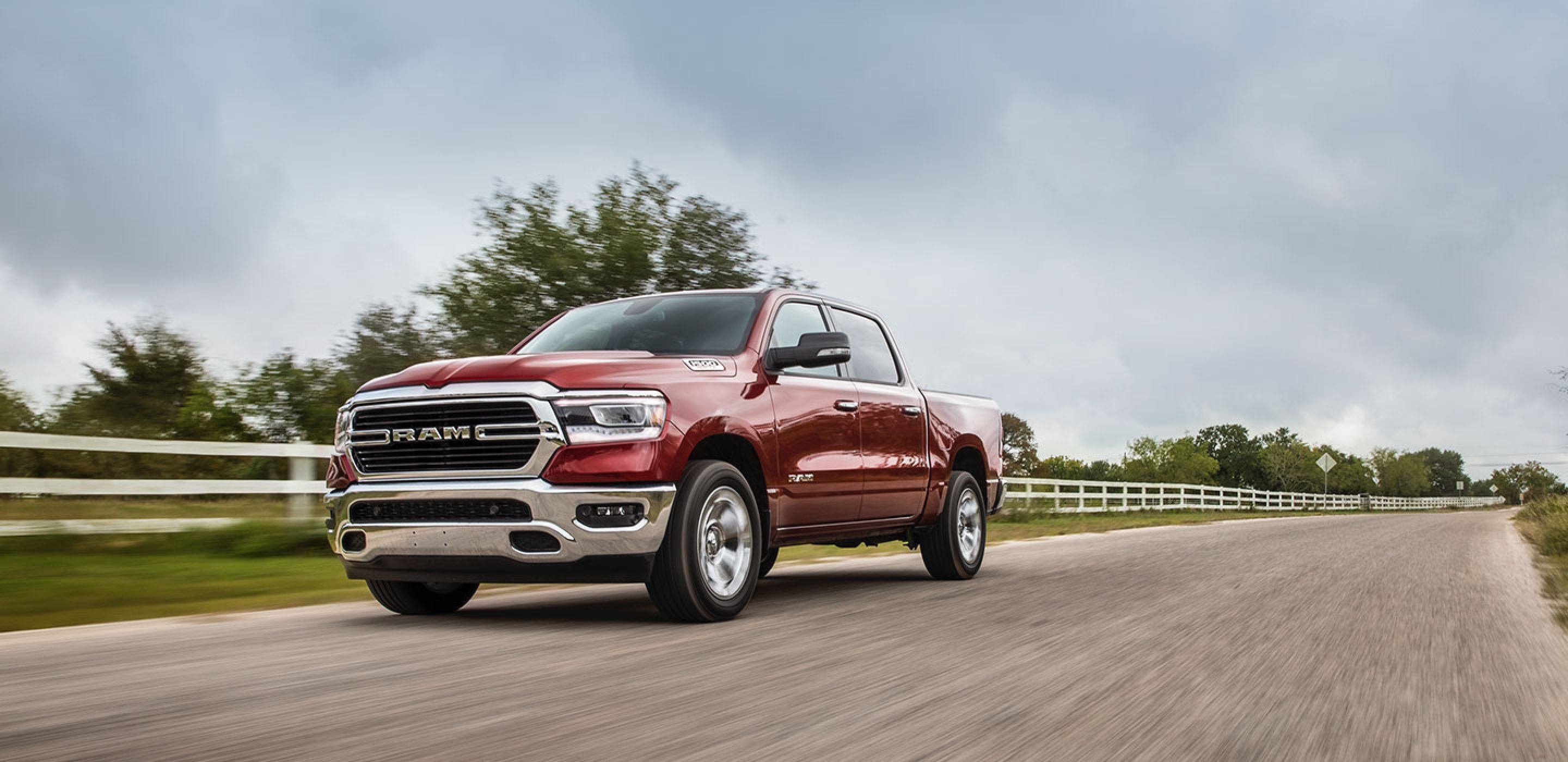 red 2020 ram 1500 driving on a country road