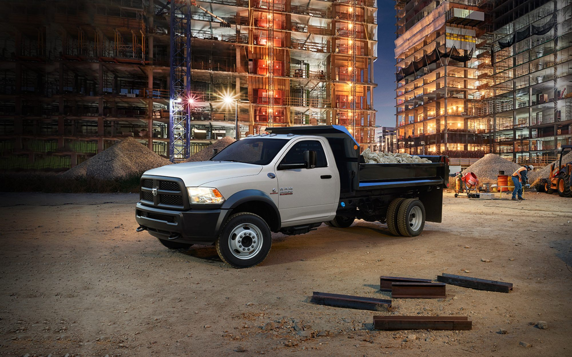 2018 ram chassis cab in a construction site with rubble stored in the truck bed