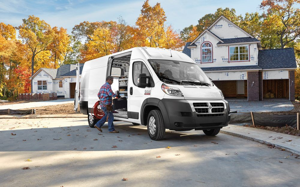 man putting construction gear into his 2018 ram promaster