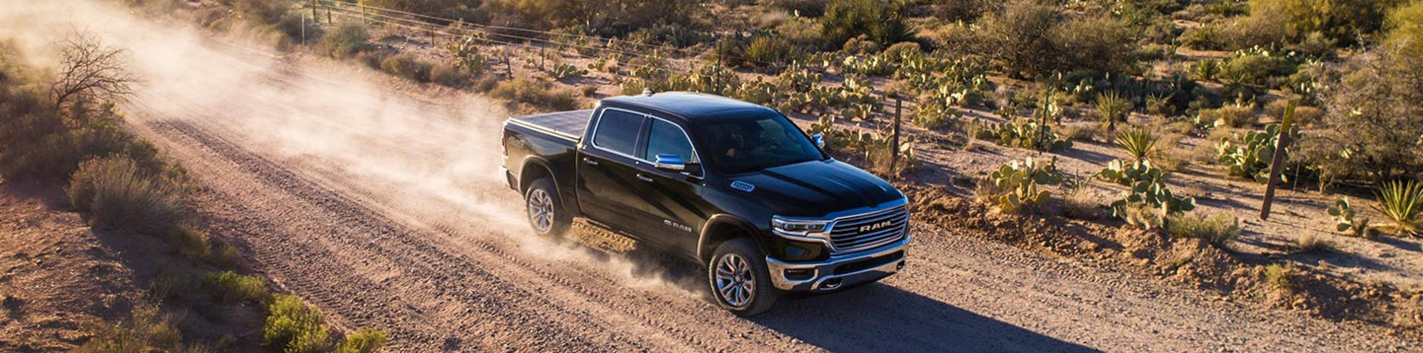 black 2019 ram 1500 driving through desert