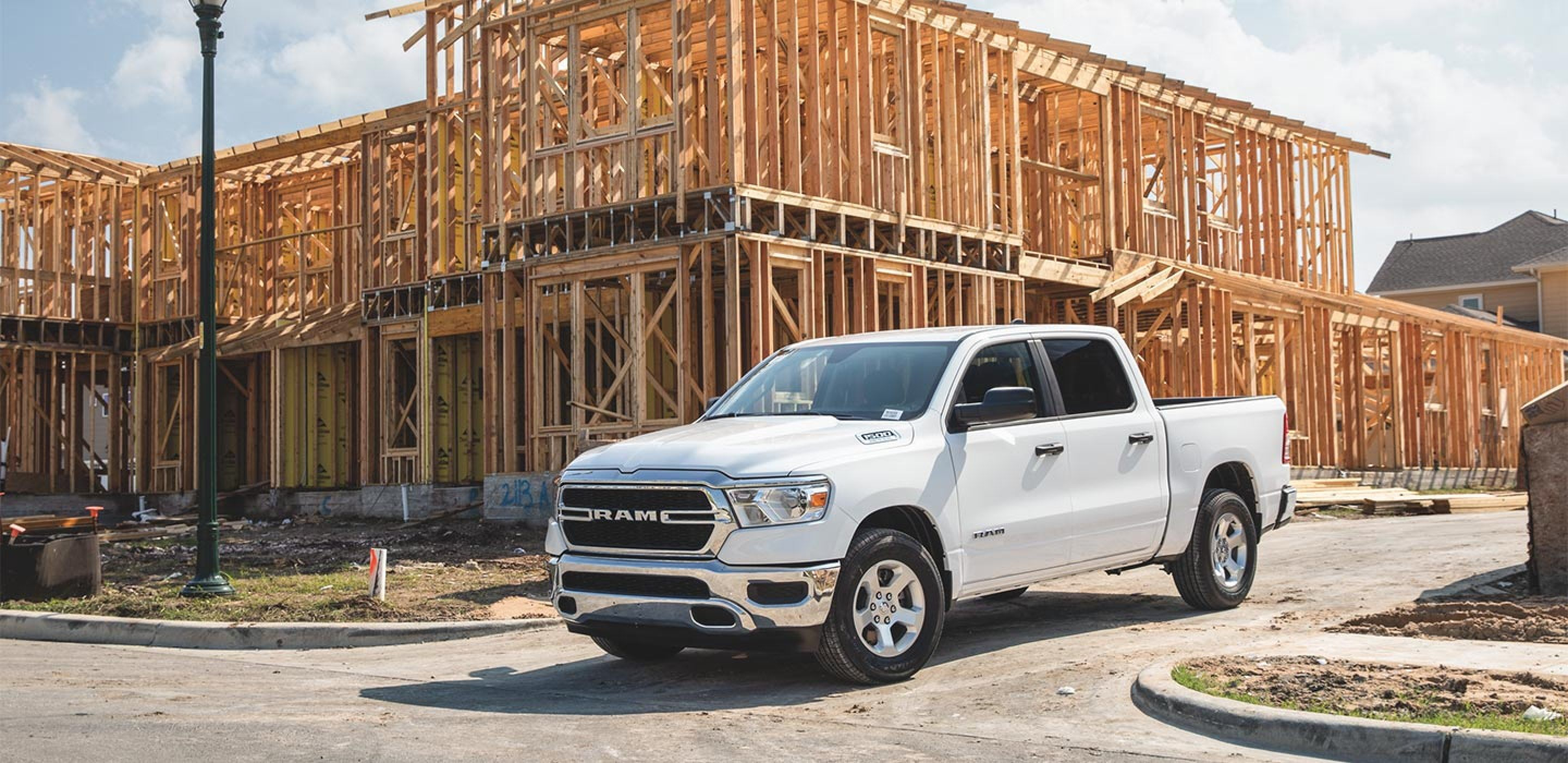 white 2020 ram 1500 parked on a construction site