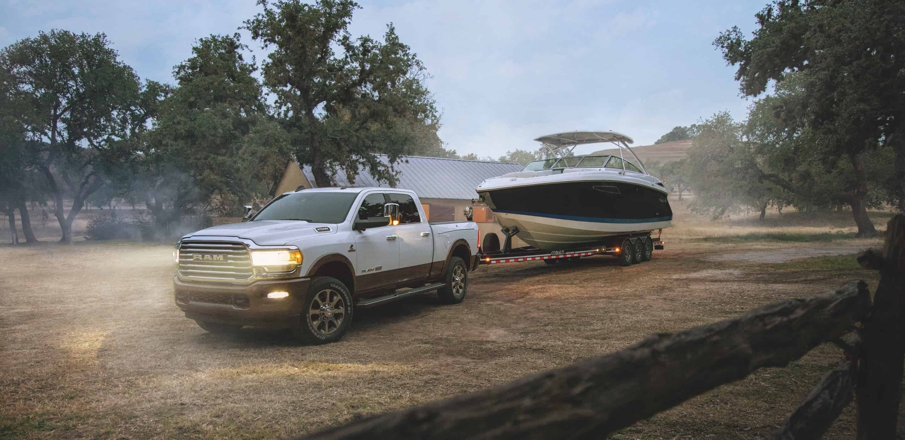 white 2020 ram 2500 towing a boat