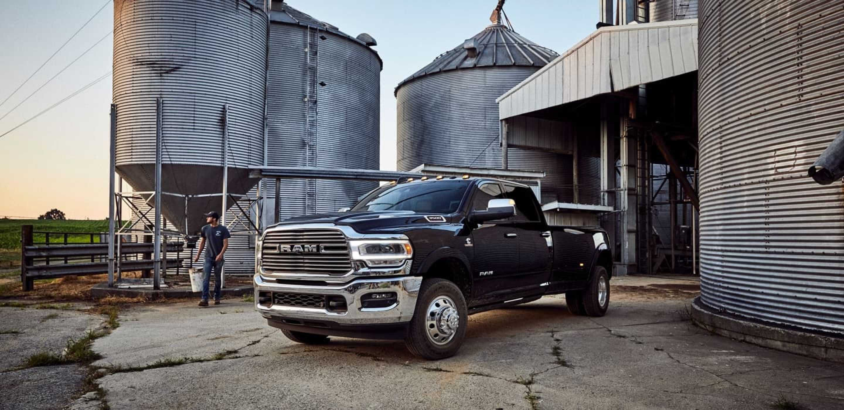 black 2020 ram 1500 parked by silos on a farm