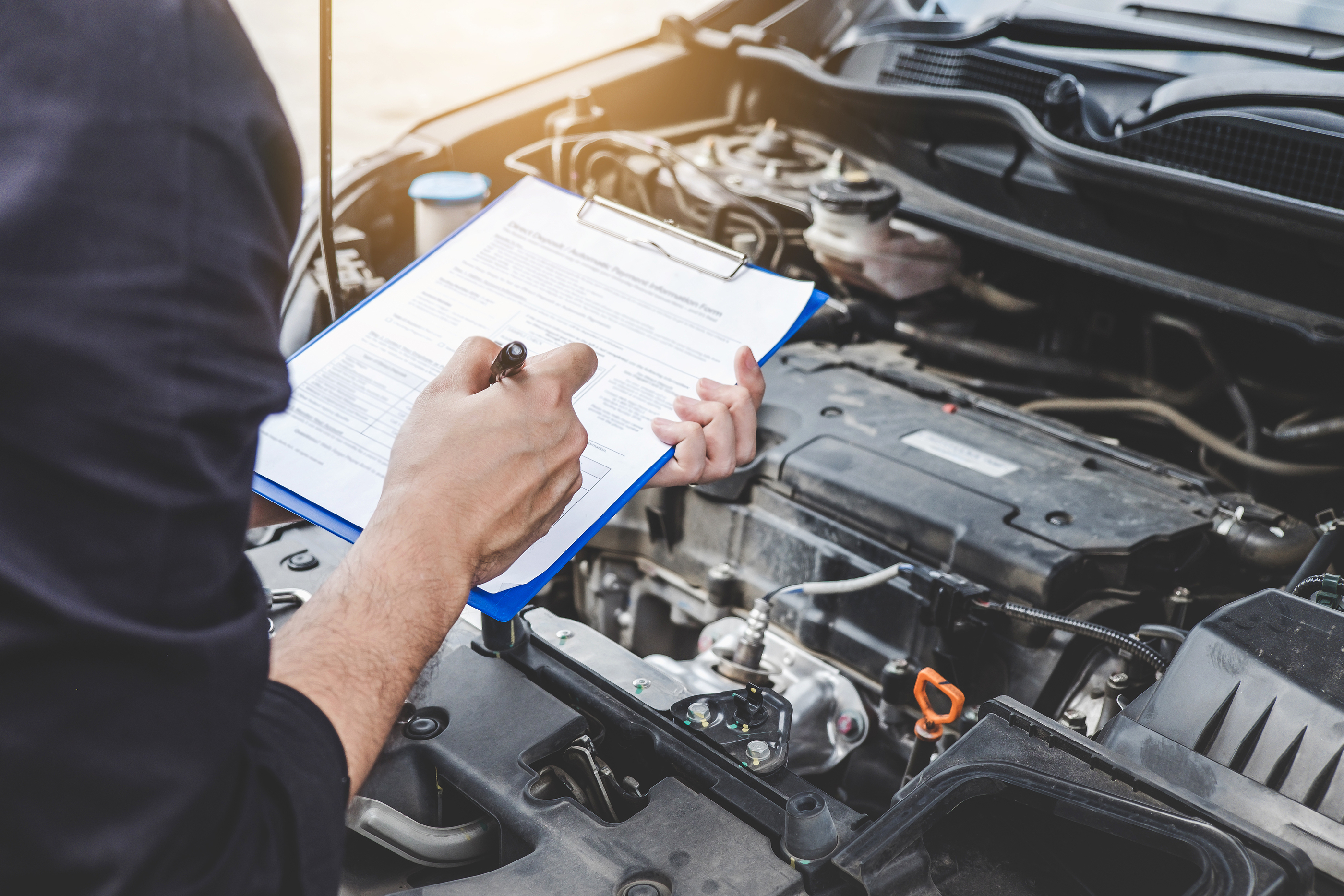 mechanic going through vehicle checklist